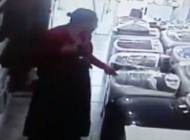Baixo Sul: Mulher furta TV ao esconder aparelho em saia; veja vídeo