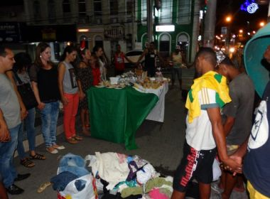 Feira: Moradores de rua participam de ceia de Natal